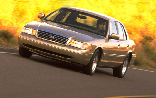 ford_crown_victoria_lx_sedan_gold_1999